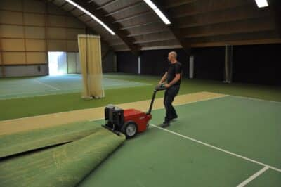 Xerowaste V-Move XL electric tug pulling tennis court flooring | Carpet remover tug | multi-purpose tug mover