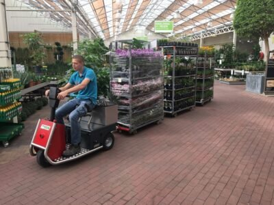 Xerowaste V-Move 650 used at a nursery to pull racks of plants | Stock chaser | Sit down riding tug
