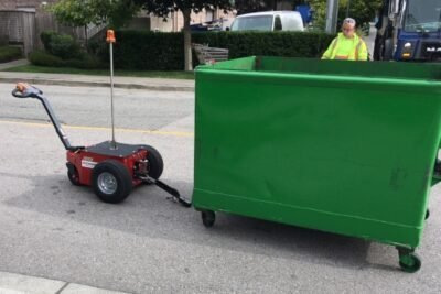 V-Move XL electric mover tug pulling bin | Xerowaste | Dumpster mover | Waste bin tug
