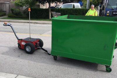 V-Move XL electric mover tug pulling bin | Xerowaste.ca | Dumpster mover | Waste bin tug