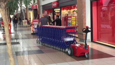 V-Move XL+ shopping cart retriever pushing carts in a shopping mall | Xerowaste.ca