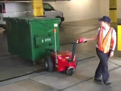 v-move xl+ dumpster mover tug pulling 3-yard bin. Also called a waste bin tug | Xerowaste.ca