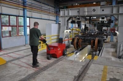 V-move XXL industrial tug or load mover moving railcar wheel assemblies during manufacturing | Xerowaste.ca