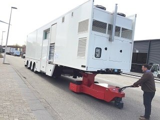 V-move semi-trailer mover moving an MRI trailer | Xerowaste.ca